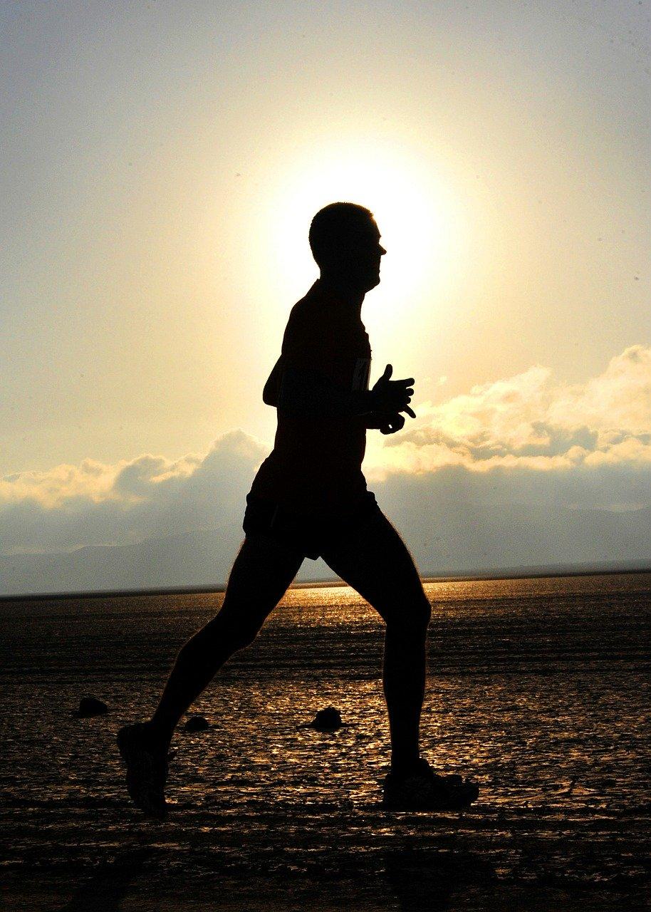 Bild: Athlet - Läufer am Strand